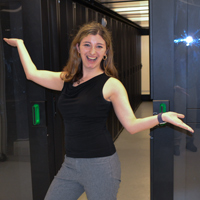 Rachel Oberman stands inside the server room of William & Mary's High Performance Computing cluster.