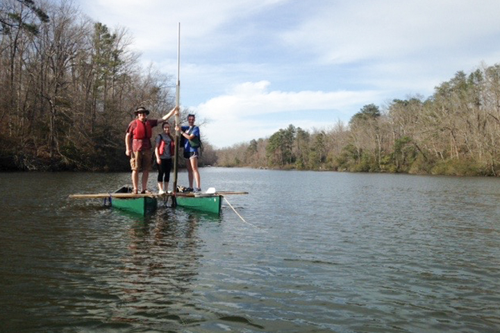 geologist Jim Kaste works with a couple of William & Mary undergraduates from a coring platform assembled from a couple of lashed-together canoes on Lake Matoaka.