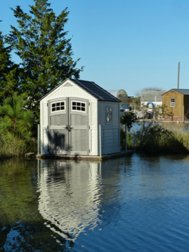 An amphibious shed rises with floodwaters in the VIMS Boat Basin. (VIMS photo)