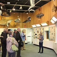Visitors listen to a presentation at the VIMS Visitors Center (Photo courtesy of VIMS)