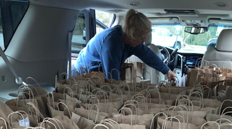 100 bagged lunches in the back of a car