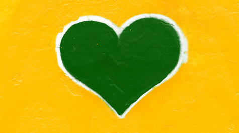 A great heart outlined in white on a yellow background