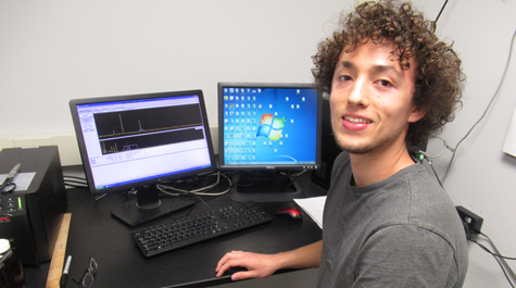 Paul Volante uses a computer to analyze decay events recorded in the gamma lab.