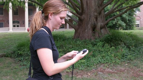 Allyson Jackson looks at a handheld electrical device