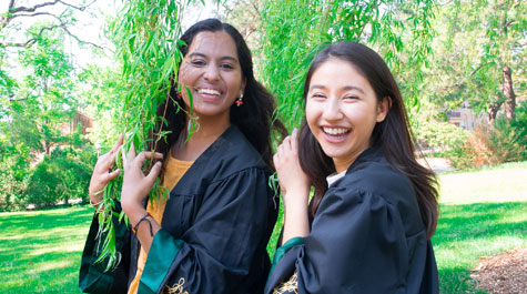 Shivani Gupta '20 and her roommate Mina Parastaran '20 in graduation gowns