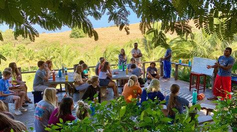 Verto Education students attend an outdoor cultural orientation class in Fiji.
