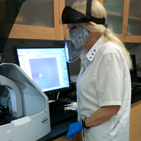 Amy Wilkerson checks out the Dektak XT surface profiler in one of William & Mary's Applied Research Center core labs