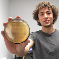 Paul Volante shows how a petri dish of honey sits atop a gamma detector