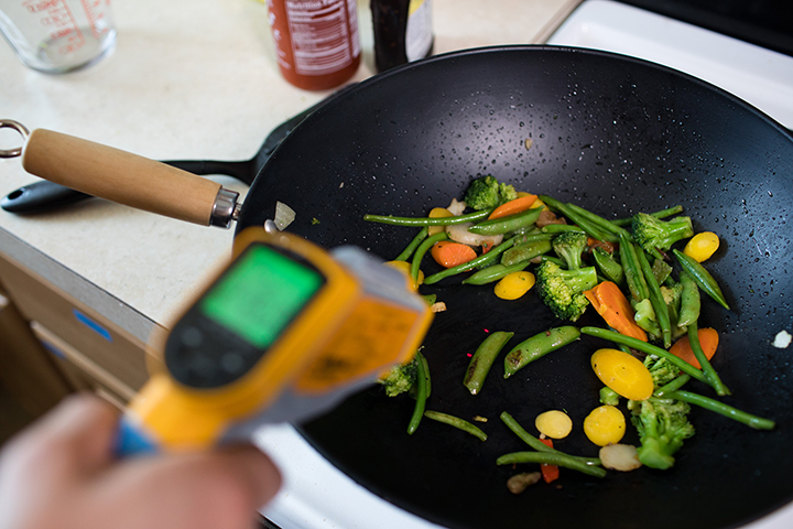 An instrument takes reading from a pan of stir fry