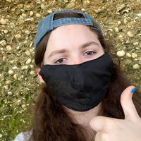 Student wearing mask gives thumbs up