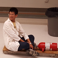 physics student holding a fire extinguisher