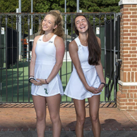 Two members of William & Mary's women's tennis team in uniform