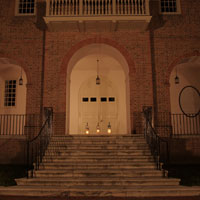 Wren Building entrance with three lit lanterns at top of stairs