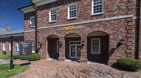 A brick building with a sign that says VCU Health