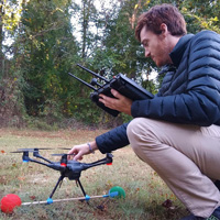 Timothy Boycott lands a drone at a survey site