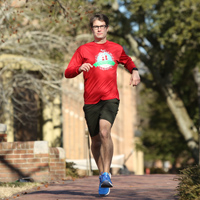 Marcus Holmes running on campus