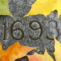 University charter year 1693 etched in stone. Fall theme.