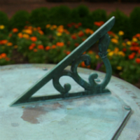 Closeup of sundial at Swem Library.