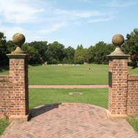 View of Sunken Garden through brick gate at east end.