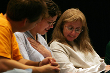 Laurie Wolf (r) joins in the playreading along with (from left) Noah Foreman and Mary Davenport. Photo by David Williard.