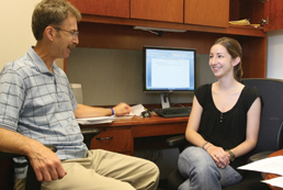 Joseph Galano, associate professor, meets with Carla Correia, first-year Psy.D. student. Galano conducts research on the prevention of child abuse and neglect, often involving students in his work. Correia is the graduate student representative on the Prevention and Promotion Advisory Council to the State Department of Mental Health.