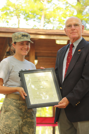 Kirsten Bertsch '10 receives the Legion of Valor Bronze Cross for Achievement from Retired Marine Brig. Gen. Edwin Kelley. (Courtesy photo)