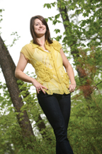 Carlos Miele's signature use of transparent and flowing silk chiffon is evident in this mustard blouse worn by Katherine McCarney '10.