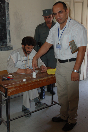 The interpreter for Mullen's group votes in Kabul.