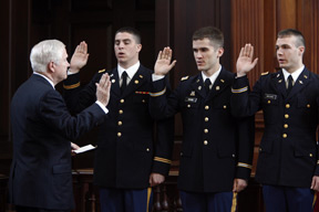 Gates swears in lieutenants at an ROTC affirmation ceremony during the 2007 commencement weekend.