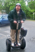 Parking enforcement officer Jason Hamlin takes a spin on one of the College's Segways