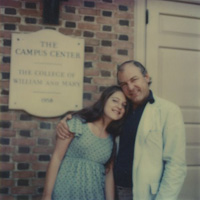 Christine Westberg and her father pose for a photo outside of the Campus Center.