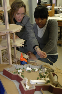 Shannon Chance (left) works with an architecture student at Hampton University.