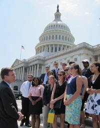 Mark Warner speaks to the community engagement fellows outside of the Captiol Building.