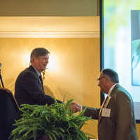 Dr. Bracken accepts congratulations from University of Georgia Dean of the College of Education, Andy M. Horne, Ph.D.