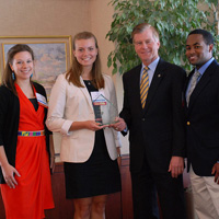 Campus Kitchen's Chelsea Estancona, Sarah Holko and Tony Batt flank Gov. McDonnell.