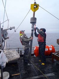 VIMS graduate student Eric Miller (L) and professor Steve Kuehl (R) prepare to core seafloor sediments in Prince William Sound, Alaska.