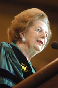 Thatcher, wearing the Chancellor's regalia, speaks at a W&M event.