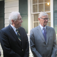 W&M President Taylor Reveley and former President Timothy Sullivan take in the ribbon-cutting ceremony.