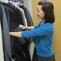 Ashleigh Brock inspects clothing available to students as part of W&M's Suits for Scholars program.