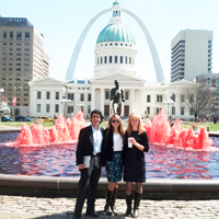 The AidData team stands in front of St. Louis' iconic arch.