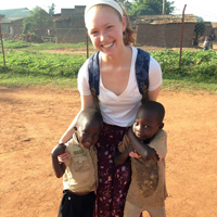 Research assistant Laura Pugh '15 with children in Mbale, Uganda. Pugh studied the role of maternal capacities of child feeding and hygiene practices.