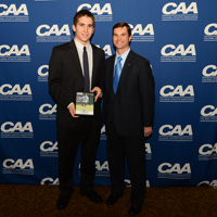 Smith receives his defensive player of the year award at the CAA banquet.