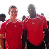 Smith with soccer great George Weah