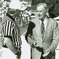 Walt Zable and an official chatting before a Tribe football game