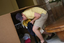 Nathan Britt pulls items out of one of the large collection boxes. Photo by Stephen Salpukas.