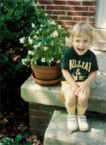 Jess was a Tribe fan from an early age. She is pictured here at age 3, decked out in green and gold.
