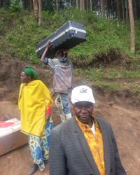 Local Rwandans help move the first delivery of equipment up the summit of Mt. Karisimbi.