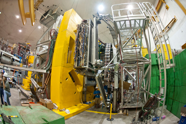 "Even though the assembled QWeak apparatus dwarfs its creators at JLab, the experiment is considered a ""finesse"" operation in comparison to detectors at Fermilab and CERN. Photo courtesy of JLab"