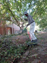 Ernest Russell cleans up storm debris after Hurricane Irene in 2011.