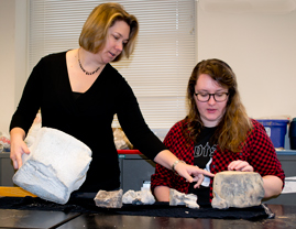 Rowan Lockwood and her student Kat Turk discuss some (non-Cornwallis) whale fossils in a William & Mary geology lab. Turk continued to work on Cornwallis at the labs at the Virginia Museum of Natural History.  Photo by Joseph McClain